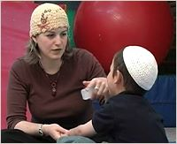 a woman works with a child